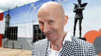 Rocky Horror creator Richard O'Brien at the Riff Raff statue in Hamilton.