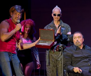 West Hollywood City Councilman John Duran presents Tim Curry, the star of 'The Rocky Horror Picture Show, ' a key to the city during the city's Halloween Carnaval celebration Oct. 31. The film marked the 40th anniversary of its release last week. (Photo by Jon Viscott)